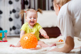 Fototapety mom playing ball with baby indoor
