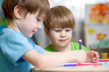 kids boys painting in nursery at home
