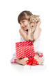 funny child girl holding gift box with kitten