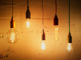 Light bulbs decorating a concrete wall