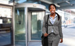 African businesswoman walking in a modern city