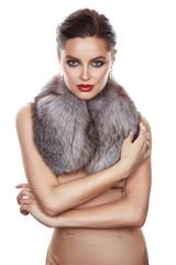 Beautiful girl evening makeup jewelry gold furs silk dress