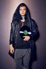Handsome sexy man singer DJ headphones stylish trendy party