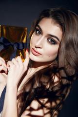 Beautiful sexy woman brunett evening makeup with box present
