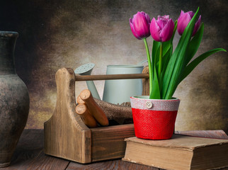 tulips pot and garden tools