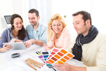 Architect students choosing colors for their project