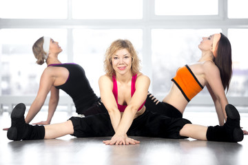 Team of three females have dance workout in class