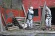 Leinwanddruck Bild - Trabajadores de amianto