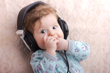 Funny baby in a big headphones.