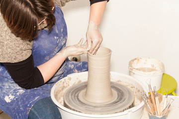 Female Potter creating a earthen jar on a Potter's wheel
