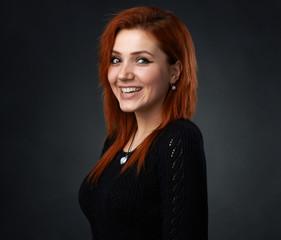 red-haired girl having fun smiling