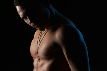 strong sexy man on  black background