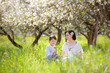 Happy woman and child in spring apple garden