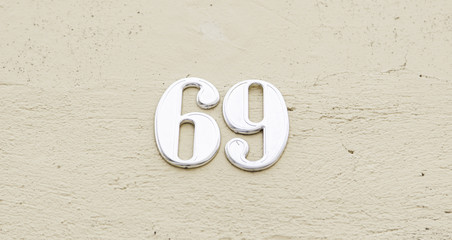 Number sixty nine on the wall of a house