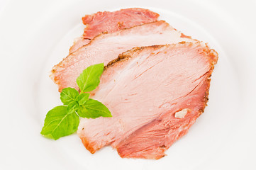 The baked pork and basil leaves