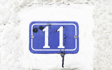 Number eleven on the wall of a house