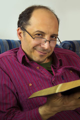 Adult man reading a bible