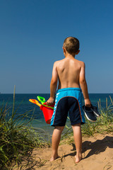 Boy heading to the beach
