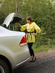 Young Woman Looking in Trunk