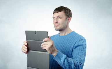 Young man with the tablet