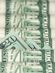 Twenty dollars between other bills
