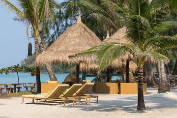 Beach chairs in a tropical beach, Thailand