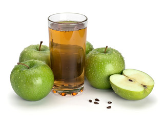 Three green apples and juice glass