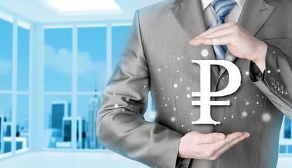 businessman protecting ruble  symbol