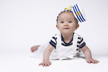 Adorable baby girl in sailor clothes