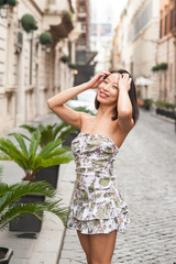 Fashion sexy asian woman relaxed posing city outdoor