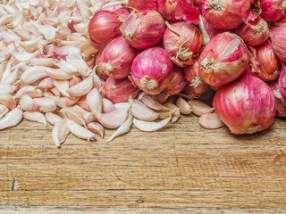 red onion and garlic on wood table