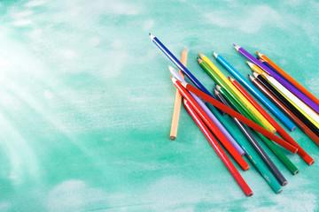 Colored pencils on a school board
