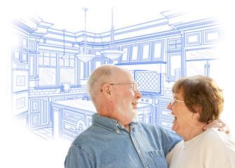 Senior Couple Over Custom Kitchen Design Drawing on White