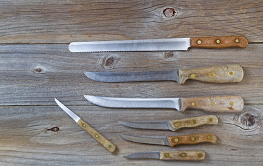 Vintage knives on rustic wood