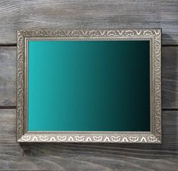 Vintage photo frame on wooden background