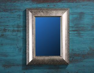 Vintage photo frame on color wooden background