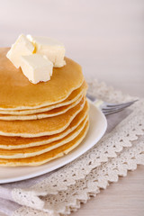 Stack of delicious pancakes with butter