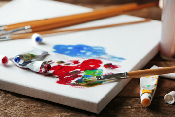 Professional art materials on wooden background