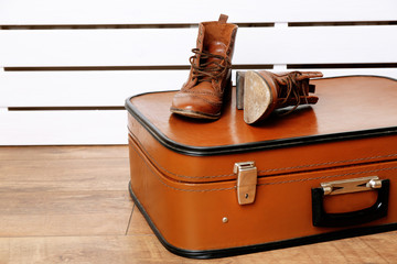 Vintage suitcase with male shoes