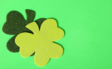 Two Shamrock Leaves on Green Background. St. Patrick's Day