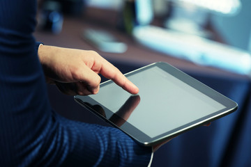 Male hand touching screen tablet close-up