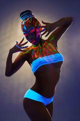Seductive female dancer with luminous body art