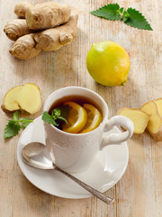Hot Tea with lemon  and ginger .