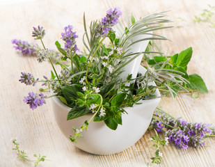 Fresh herbs on a wooden table