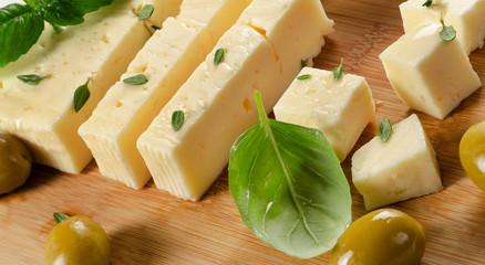 Feta cheese on a wooden cutting board.