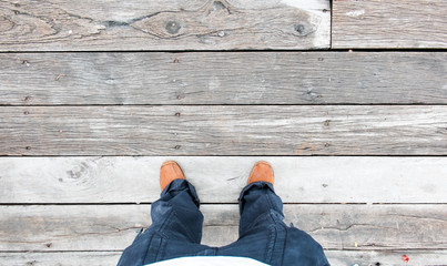 Leather shoe at an aerial view on wooden plank floors