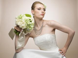 Model posing in wedding dress