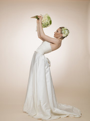 Bride you are raise high the bouquet