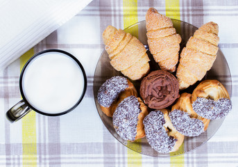 cup of milk and cookies with coconut and chocolate