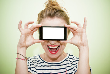 Young woman with smartphone over eyes